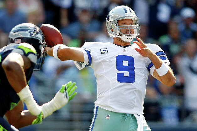 Dallas Cowboys quarterback Tony Romo drops back to pass against the Seattle Seahawks in the second half of an NFL football game, Sunday, Sept. 16, 2012, in Seattle. (AP Photo/John Froschauer) Photo: John Froschauer, Associated Press / FR74207 AP