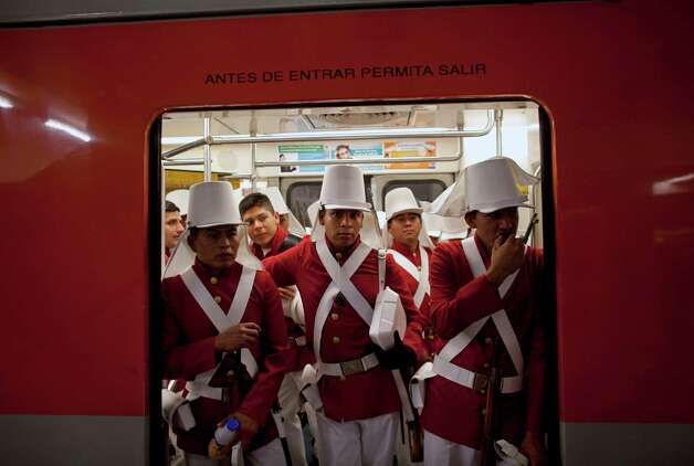 Members of the Mexican army wearing historical uniforms ride in the subway on their way to downtown Mexico City, prior to the military parade of the Independence Day celebrations, Mexico City, Sunday Sept. 16, 2012. Mexico celebrates the 202nd anniversary of its 1810 independence uprising. (AP Photo/Alexandre Meneghini) Photo: Alexandre Meneghini, Associated Press / AP