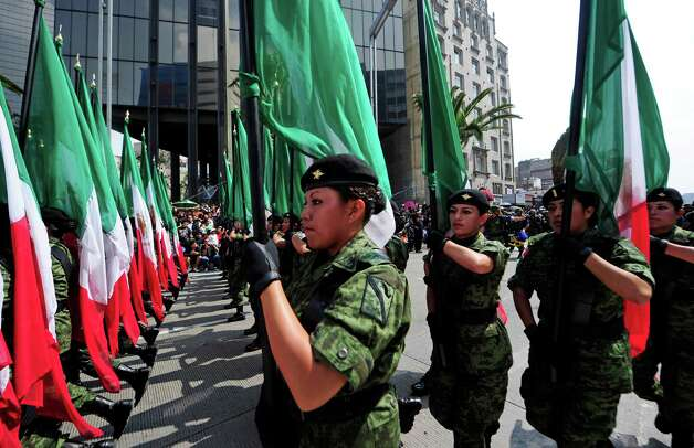 Mexican female soldiers march during the celebration of the 202nd anniversary of the country's independence at Juarez Avenue in Mexico City on September 16, 2012.   AFP PHOTO/Alfredo EstrellaALFREDO ESTRELLA/AFP/GettyImages Photo: ALFREDO ESTRELLA, AFP/Getty Images / ALFREDO ESTRELLA