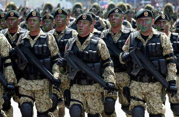 A Mexican Army Special Forces battalion march during the celebration of the 202nd anniversary of the country's independence at Juarez Avenue in Mexico City on September 16, 2012.   AFP PHOTO/Alfredo EstrellaALFREDO ESTRELLA/AFP/GettyImages Photo: ALFREDO ESTRELLA, AFP/Getty Images / AFP
