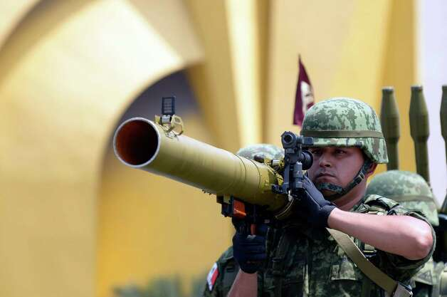 A Mexican Army soldier holds an anti-tank weapon during the celebration of the 202nd anniversary of the country's independence at Juarez Avenue in Mexico City on September 16, 2012.   AFP PHOTO/Alfredo EstrellaALFREDO ESTRELLA/AFP/GettyImages Photo: ALFREDO ESTRELLA, AFP/Getty Images / AFP