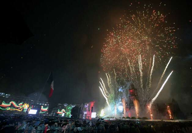 People watch as fireworks light up the sky in Zocalo Square to mark Mexico's Independence Day in Mexico City on September 15, 2012. Photo: ALFREDO ESTRELLA, AFP/Getty Images / AFP