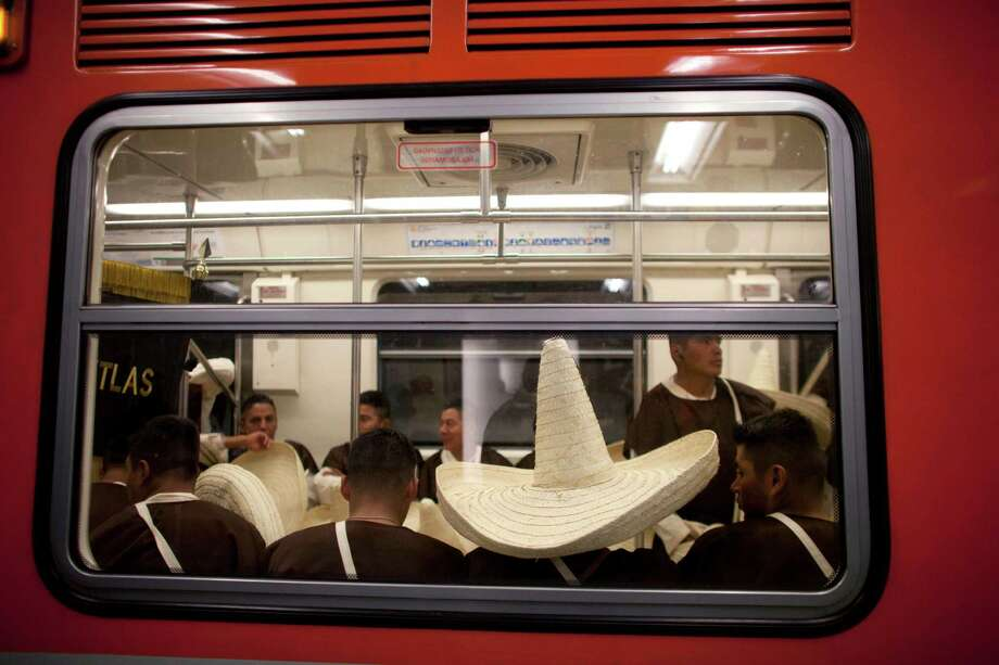 Members of the military, wearing costumes representing the 1911 revolutionary forces, ride in the subway on their way to downtown Mexico City, prior to the military parade of the Independence Day celebrations, Mexico City, Sunday Sept. 16, 2012.  Photo: Alexandre Meneghini, Associated Press / AP