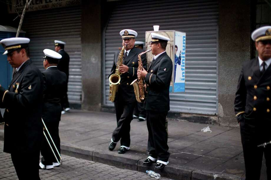 Members of the Mexican navy band practice prior to the military parade of the Independence Day celebrations, Mexico City, Sunday Sept. 16, 2012.  Photo: Alexandre Meneghini, Associated Press / AP