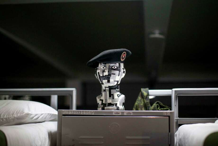 A Mexican army special forces beret sits on a mannequin's head  at a dormitory in a military base in Mexico City, prior to the military parade of the Independence Day celebrations, Sunday Sept. 16, 2012.  Photo: Alexandre Meneghini, Associated Press / AP