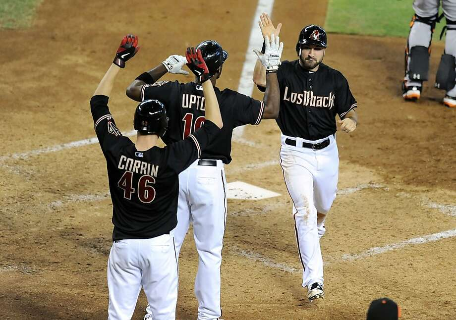 PHOENIX, AZ - SEPTEMBER 16:  Adam Eaton #6 of the Arizona Diamondbacks celebrates scoring a run with teammates Justin Upton #10 and Patrick Corbin #46 against the San Francisco Giants at Chase Field on September 16, 2012 in Phoenix, Arizona.  (Photo by Norm Hall/Getty Images) Photo: Norm Hall, Getty Images