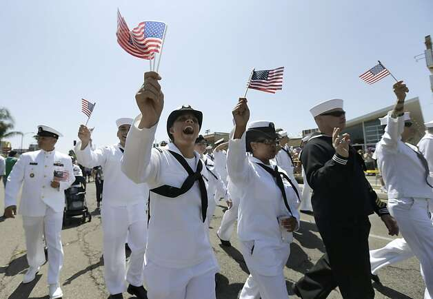 "FILE - In this Saturday, July 21, 2012 file photo, sailors march in uniform during the gay pride parade in San Diego. For the first time ever, U.S. service members had marched in a gay pride event decked out in uniform Saturday, after a recent memorandum from the Defense Department to all military branches made an allowance for the San Diego parade - even though its policy generally bars troops from marching in uniform in parades. On Sept. 20, 2011, the repeal of the policy known as ""don't ask, don't tell"" took effect, enabling gay and lesbian members of the military to serve openly, no longer forced to lie and keep their personal lives under wraps. One year later, the Pentagon says repeal has gone smoothly, with no adverse effect on morale, recruitment or readiness. Some critics persist with complaints that repeal has infringed on service members whose religious faiths condemn homosexuality. Instances of anti-gay harassment have not ended. And activists are frustrated that gay and lesbian military families don't yet enjoy the benefits and services extended to other military families. Yet the clear consensus is that repeal has produced far more joy and relief than dismay and indignation. (AP Photo/Gregory Bull) Photo: Gregory Bull, Associated Press"