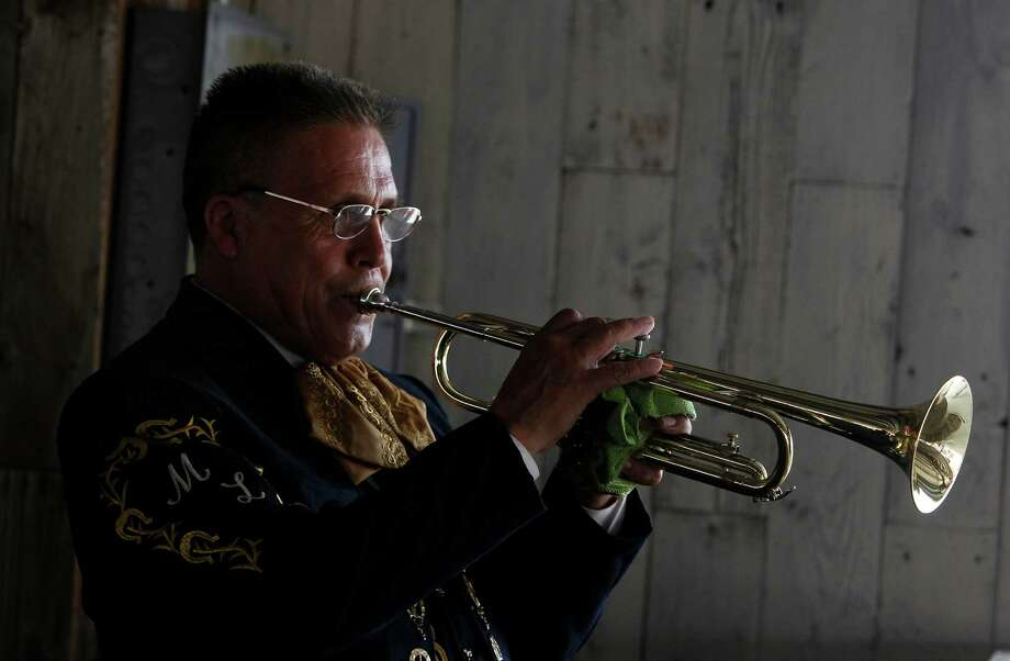 Julio Torres warms-up before performing with 'El Mariachi Loco' during the Fiestas Patrias at Traders Village in recognition of Mexican Independence Day on Sunday, Sept. 16, 2012, in Houston. Photo: Mayra Beltran, Houston Chronicle / © 2012 Houston Chronicle