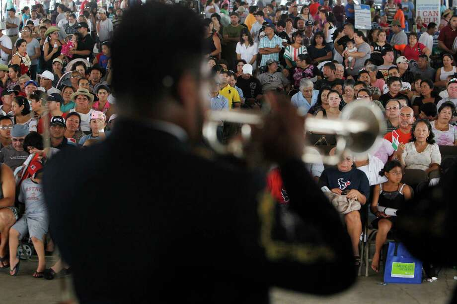 The audience listens to 'El Mariachi Loco' during the Fiestas Patrias at Traders Village in recognition of Mexican Independence Day on Sunday, Sept. 16, 2012, in Houston. Photo: Mayra Beltran, Houston Chronicle / © 2012 Houston Chronicle