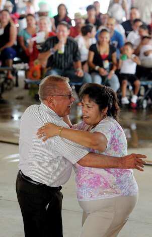 Santiago Reyna dances with Marta Perez during the Fiestas Patrias at Traders Village in recognition of Mexican Independence Day on Sunday, Sept. 16, 2012, in Houston. Photo: Mayra Beltran, Houston Chronicle / © 2012 Houston Chronicle