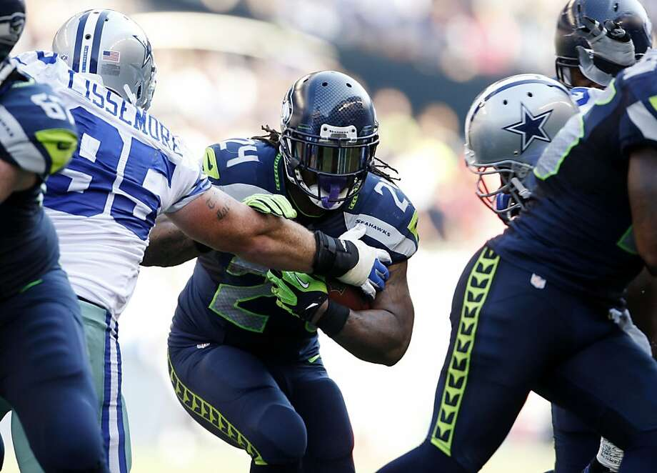 Marshawn Lynch ran for 122 yards as the Seahawks proved to be more physical than the Cowboys. Photo: Kevin P. Casey, Associated Press
