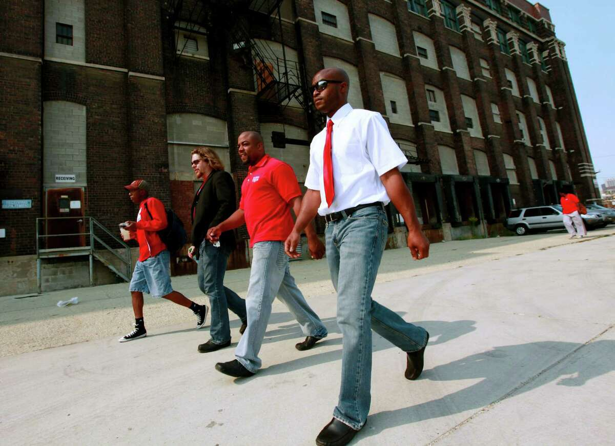 Chicago Teachers Union delegates arrive for a meeting Sunday, Sept. 16, 2012 in Chicago. Hundreds of CTU delegates are expected to review a proposed contract and vote on whether to suspend the teachers strike which has kept more than 350,000 students out of school since Monday. (AP Photo/Sitthixay Ditthavong)