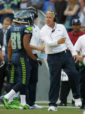 Seattle Seahawks head coach Pete Carroll gestures to Golden Tate against the Dallas Cowboys in the second half of an NFL football game, Sunday, Sept. 16, 2012, in Seattle. The Seahawks won 27-7. (AP Photo/John Froschauer) Photo: John Froschauer, Associated Press / FR74207 AP