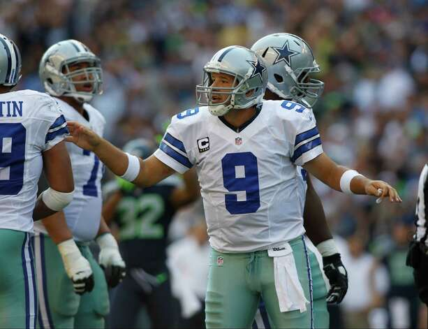 Dallas Cowboys quarterback Tony Romo makes a point after a play against the Seattle Seahawks in the second half of an NFL football game, Sunday, Sept. 16, 2012, in Seattle. (AP Photo/John Froschauer) Photo: John Froschauer, Associated Press / FR74207 AP