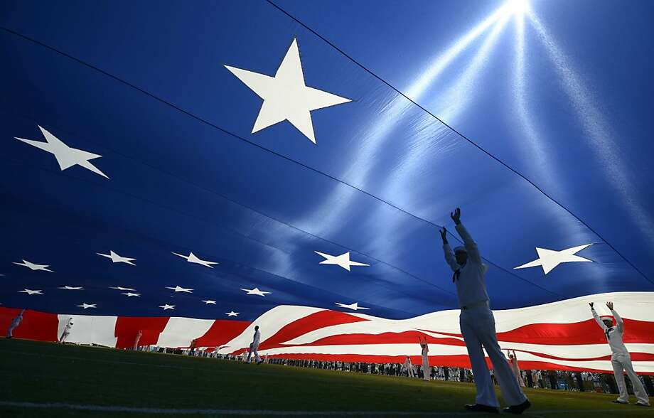U.S. Armed forces hold a giant American Flag on the field at the start of the San Diego Chargers against the Tennessee Titans on September 16, 2012 at Qualcomm Stadium in San Diego, California. (Photo by Donald Miralle/Getty Images) Photo: Donald Miralle, Getty Images