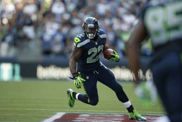 Seattle Seahawks running back Robert Turbin runs the ball against the Dallas Cowboys in the second half of an NFL football game, Sunday, Sept. 16, 2012, in Seattle. Seattle defeated Dallas 27-7. (AP Photo/Kevin P. Casey) Photo: Kevin P. Casey, Associated Press / FR132181 AP