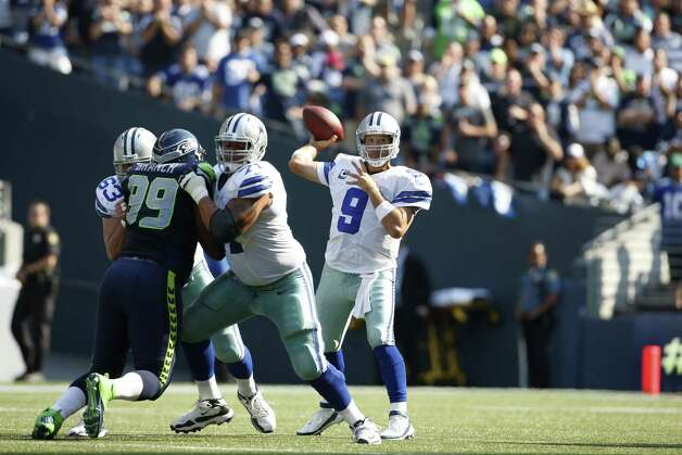 Dallas Cowboys quarterback Tony Romo throws against the Seattle Seahawks in the second half of an NFL football game, Sunday, Sept. 16, 2012, in Seattle. Seattle defeated Dallas 27-7.(AP Photo/Kevin P. Casey) Photo: Kevin P. Casey, Associated Press / FR132181 AP