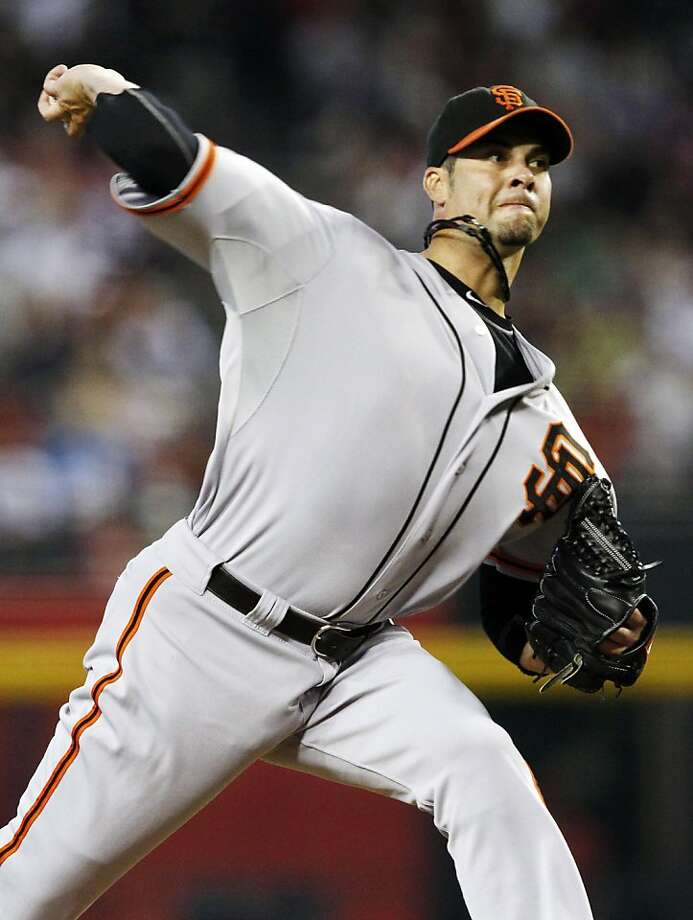 San Francisco Giants' Ryan Vogelsong throws against the Arizona Diamondbacks in the first inning of a baseball game, Sunday, Sept. 16, 2012, in Phoenix. (AP Photo/Ross D. Franklin) Photo: Ross D. Franklin, Associated Press