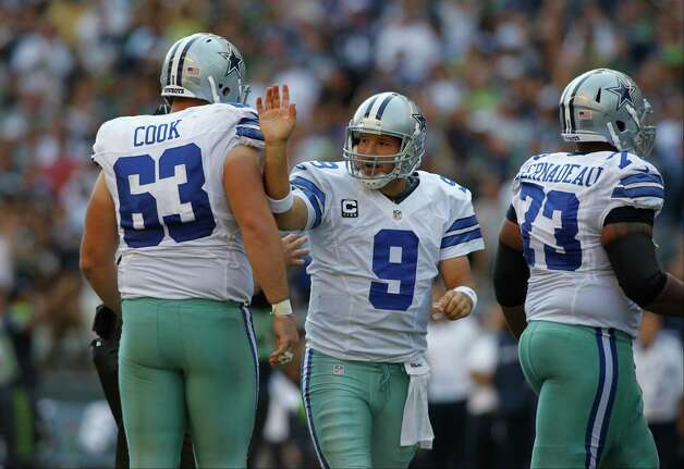 Dallas Cowboys quarterback Tony Romo tries to pass between Ryan Cook, left, and Mackenzy Bernadeau against the Seattle Seahawks in the second half of an NFL football game, Sunday, Sept. 16, 2012, in Seattle. (AP Photo/John Froschauer) Photo: John Froschauer, Associated Press / FR74207 AP
