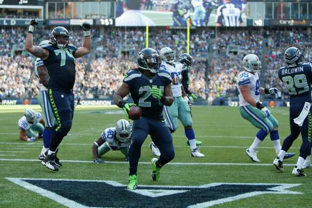 Seattle Seahawks' Marshawn Lynch runs for a touchdown against the Dallas Cowboys in the second half of an NFL football game, Sunday, Sept. 16, 2012, in Seattle. (AP Photo/Kevin P. Casey) Photo: Kevin P. Casey, Associated Press / FR132181 AP