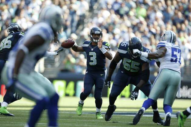 Seattle Seahawks quarterback Russell Wilson throws against the Dallas Cowboys in the second half of an NFL football game, Sunday, Sept. 16, 2012, in Seattle. Seattle defeated Dallas 27-7. (AP Photo/Kevin P. Casey) Photo: Kevin P. Casey, Associated Press / FR132181 AP