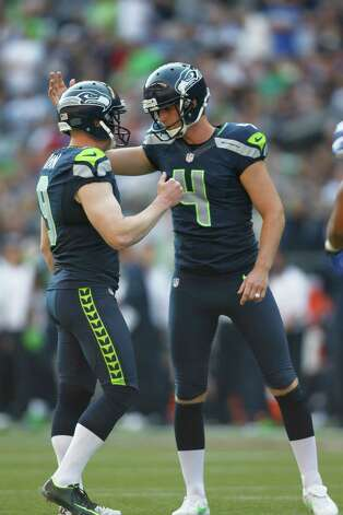 Seattle Seahawks' Steven Hauschka, right, is congratulated by placeholder Jon Ryan after kicking a point after touchdown against the Dallas Cowboys in the second half of an NFL football game, Sunday, Sept. 16, 2012, in Seattle. (AP Photo/John Froschauer) Photo: John Froschauer, Associated Press / FR74207 AP