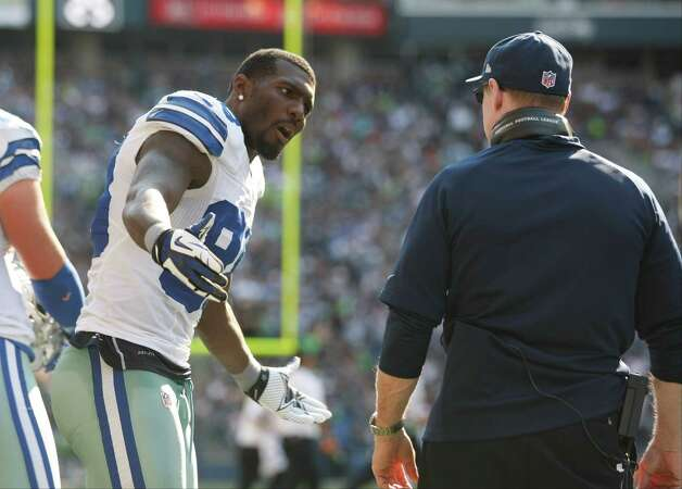 Dallas Cowboys' Dez Bryant has words with a coach on the sidelines against the Seattle Seahawks in the second half of an NFL football game, Sunday, Sept. 16, 2012, in Seattle. The Seahawks won 27-7. (AP Photo/John Froschauer) Photo: John Froschauer, Associated Press / FR74207 AP
