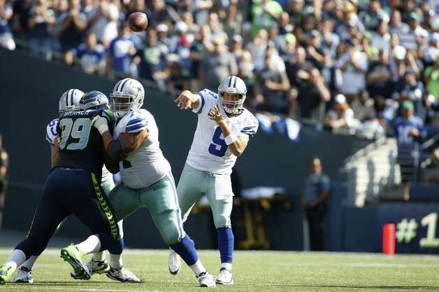 Dallas Cowboys quarterback Tony Romo throws the ball against the Seattle Seahawks in the second half of an NFL football game, Sunday, Sept. 16, 2012, in Seattle. Seattle defeated Dallas 27-7. (AP Photo/Kevin P. Casey) Photo: Kevin P. Casey, Associated Press / FR132181 AP