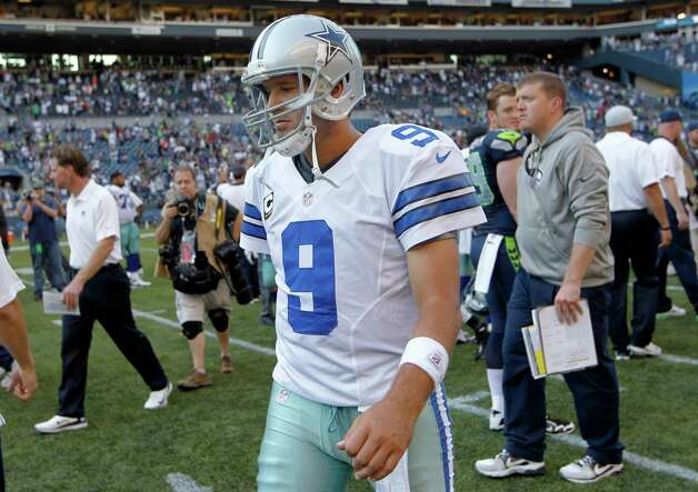 Dallas Cowboys quarterback Tony Romo (9) walks of the field after a 27-7 loss to the Seattle Seahawks in an NFL football game on Sunday, Sept. 16, 2012, in Seattle. (AP Photo/John Froschauer) Photo: John Froschauer, Associated Press / FR74207 AP