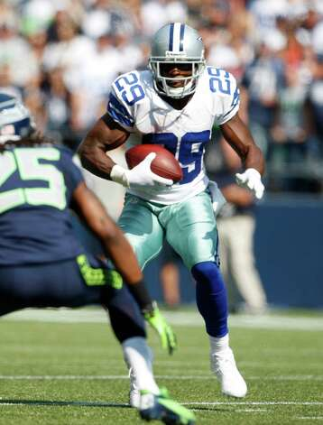 Dallas Cowboys' DeMarco Murray in action against the Seattle Seahawks in the first half of an NFL football game, Sunday, Sept. 16, 2012, in Seattle. (AP Photo/Kevin P. Casey) Photo: Kevin P. Casey, Associated Press / FR132181 AP