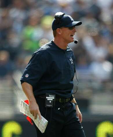Dallas Cowboys head coach Jason Garrett in action against the Seattle Seahawks in the first half of an NFL football game, Sunday, Sept. 16, 2012, in Seattle. (AP Photo/John Froschauer) Photo: John Froschauer, Associated Press / FR74207 AP