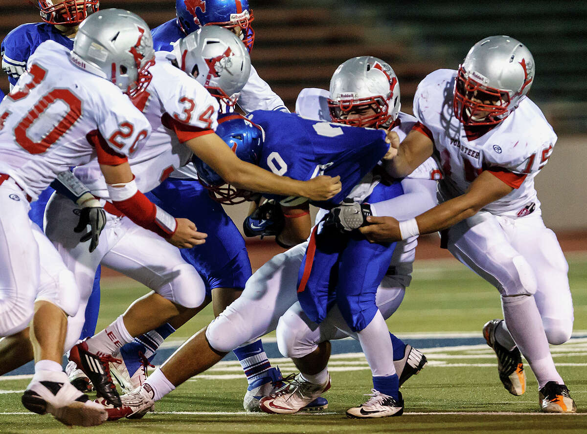Jefferson's Mark Mangel is tackled by Edison's Thomas Garza (left) and Edison's Adrian Fernandez during second half action of the Tommy Bowl Saturday Nov. 10, 2012 at Alamo Stadium. Jefferson won 30-13.