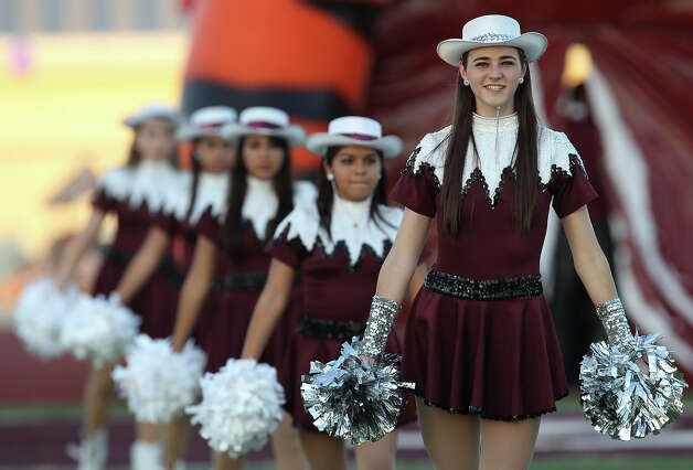 Floresville High School dance team members prepare for the entrance of their football team in a game against Harlandale in Floresville, Texas on Friday, Oct. 5, 2012. Photo: Tom Reel, San Antonio Express-News / ©2012 San Antono Express-News