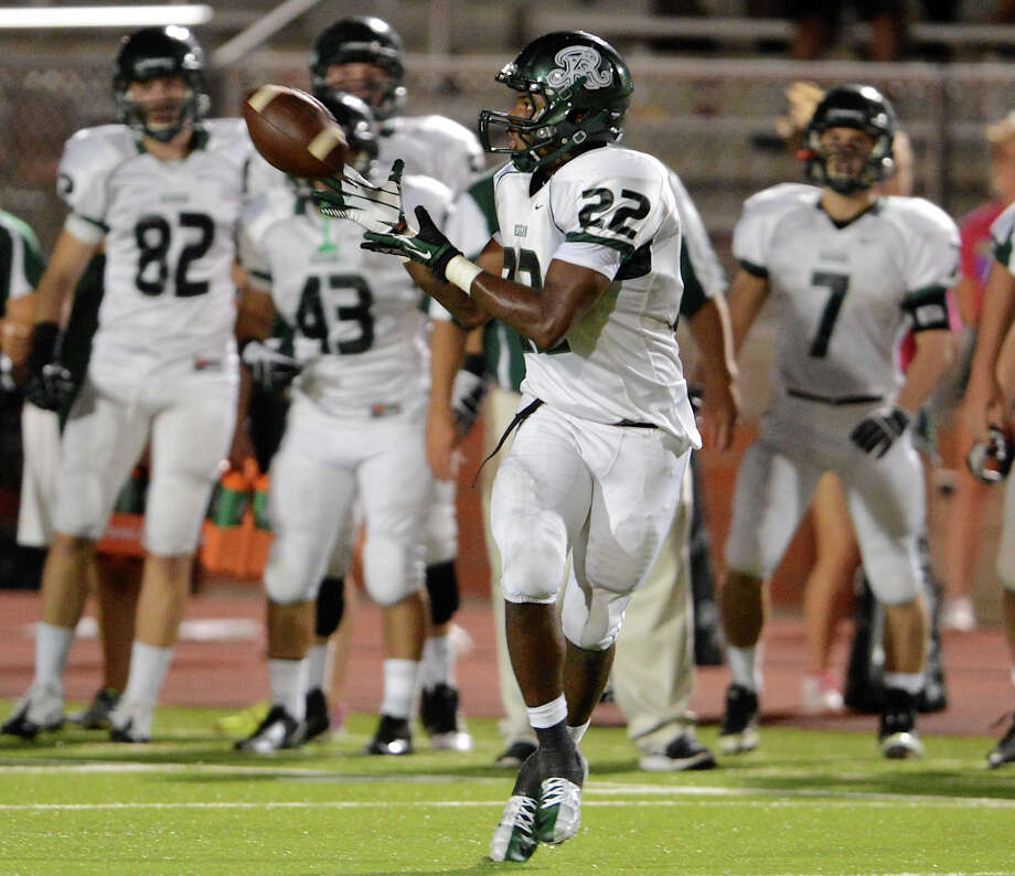 Devone Thomas celebrates a touchdown catch for the Rough Riders as Roosevelt hosts Canyon at Heroes Stadium on September 15, 2012. Photo: JOHN ALBRIGHT, San Antonio Express-News / San Antonio Express-News