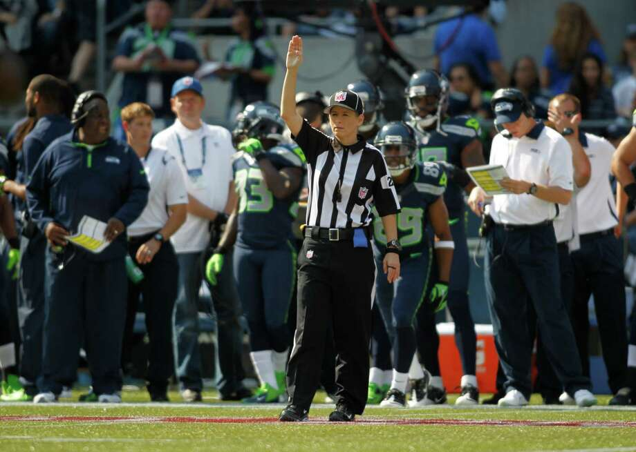 NFL official Shannon Eastin on the field against the Dallas Cowboys Seattle Seahawks in the first half of an NFL football game, Sunday, Sept. 16, 2012, in Seattle. Photo: AP