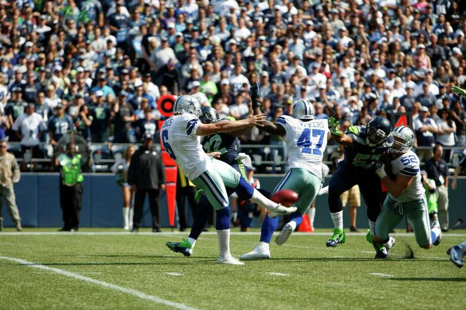 Dallas Cowboys' Chris Jones, left, has his kick blocked by the Seattle Seahawks in the first half of an NFL football game, Sunday, Sept. 16, 2012, in Seattle. Photo: AP