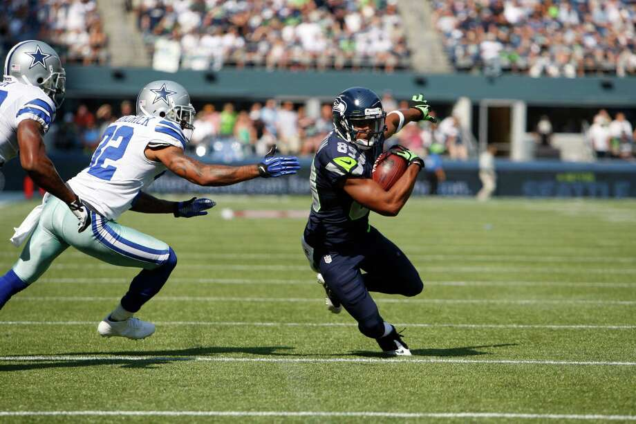 Seattle Seahawks' Doug Baldwin carries the ball with Dallas Cowboys' Orlando Scandrick defending in the first half of an NFL football game, Sunday, Sept. 16, 2012, in Seattle. Photo: AP