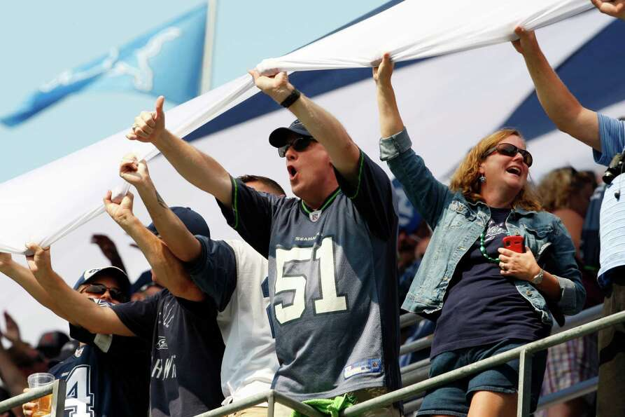 Fans cheer before an NFL football game between the Dallas Cowboys and Seattle Seahawks, Sunday, Sept