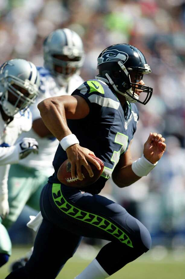 Seattle Seahawks quarterback Russell Wilson in action against the Dallas Cowboys in the first half of an NFL football game, Sunday, Sept. 16, 2012, in Seattle. Photo: AP