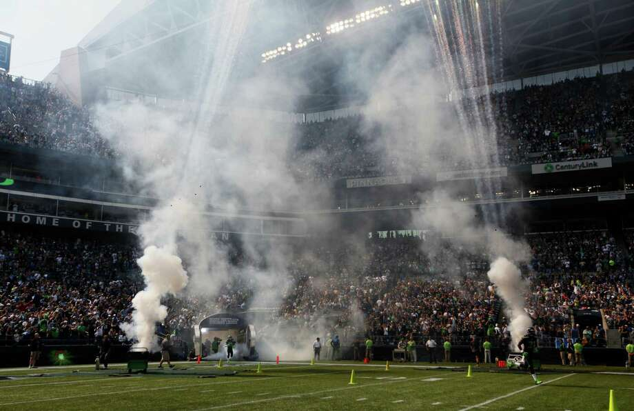 Smoke rises from fireworks on the field during player introductions before an NFL football game between the Dallas Cowboys and Seattle Seahawks, Sunday, Sept. 16, 2012, in Seattle. The Seahawks won 27-7. Photo: AP