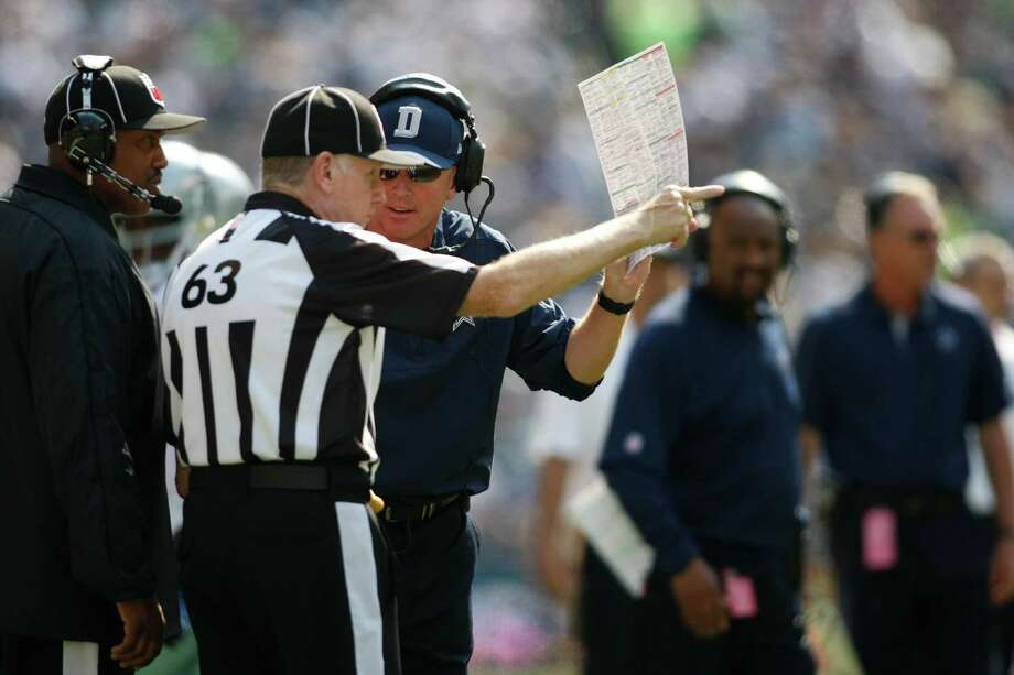 Dallas Cowboys head coach Jason Garrett argues with Lynn Lawhon during the game against the Seattle Seahawks in the first half of an NFL football game, Sunday, Sept. 16, 2012, in Seattle. Photo: AP