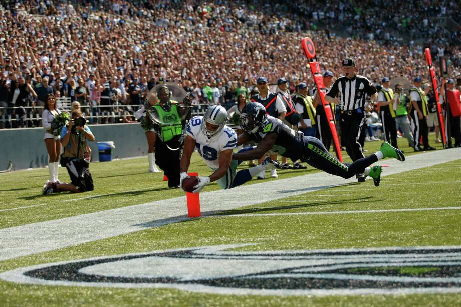 Dallas Cowboys Miles Austin scores against the Seattle Seahawks in the first half of an NFL football game, Sunday, Sept. 16, 2012, in Seattle. Photo: AP