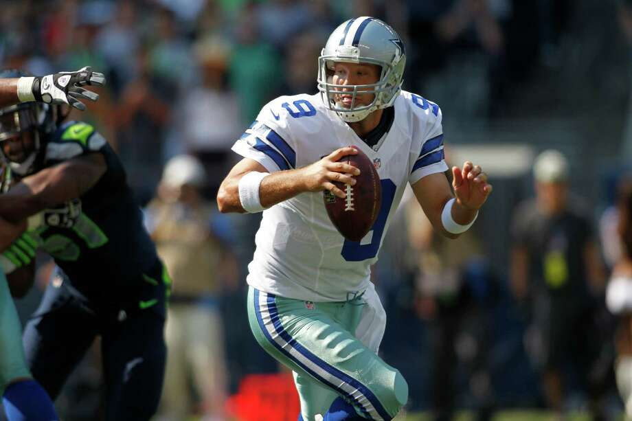 Dallas Cowboys' quarterback Tony Romo scrambles against the Seattle Seahawks in the first half of an NFL football game, Sunday, Sept. 16, 2012, in Seattle. Photo: AP
