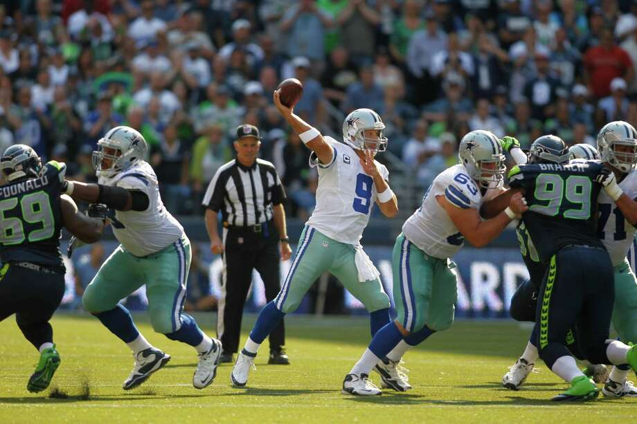Dallas Cowboys quarterback Tony Romo makes a pass against the Seattle Seahawks in the second half of an NFL football game, Sunday, Sept. 16, 2012, in Seattle. Photo: AP