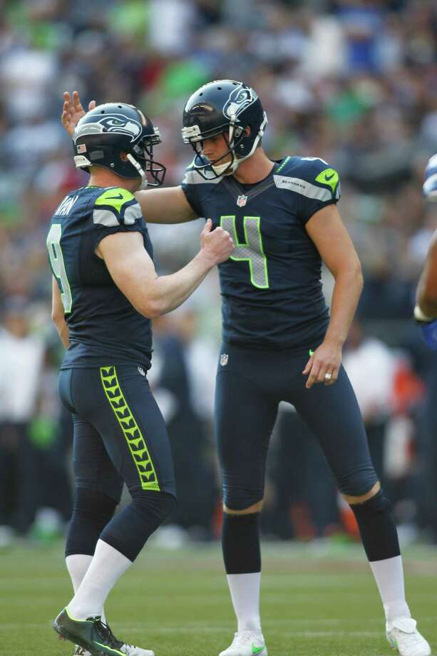 Seattle Seahawks' Steven Hauschka, right, is congratulated by placeholder Jon Ryan after kicking a point after touchdown against the Dallas Cowboys in the second half of an NFL football game, Sunday, Sept. 16, 2012, in Seattle. Photo: AP