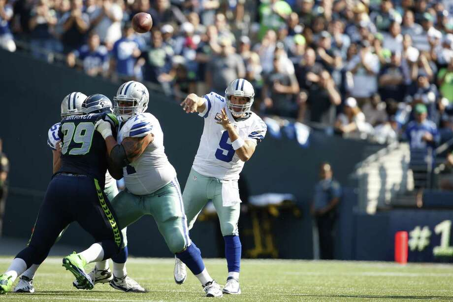 Dallas Cowboys quarterback Tony Romo throws the ball against the Seattle Seahawks in the second half of an NFL football game, Sunday, Sept. 16, 2012, in Seattle. Seattle defeated Dallas 27-7. Photo: AP