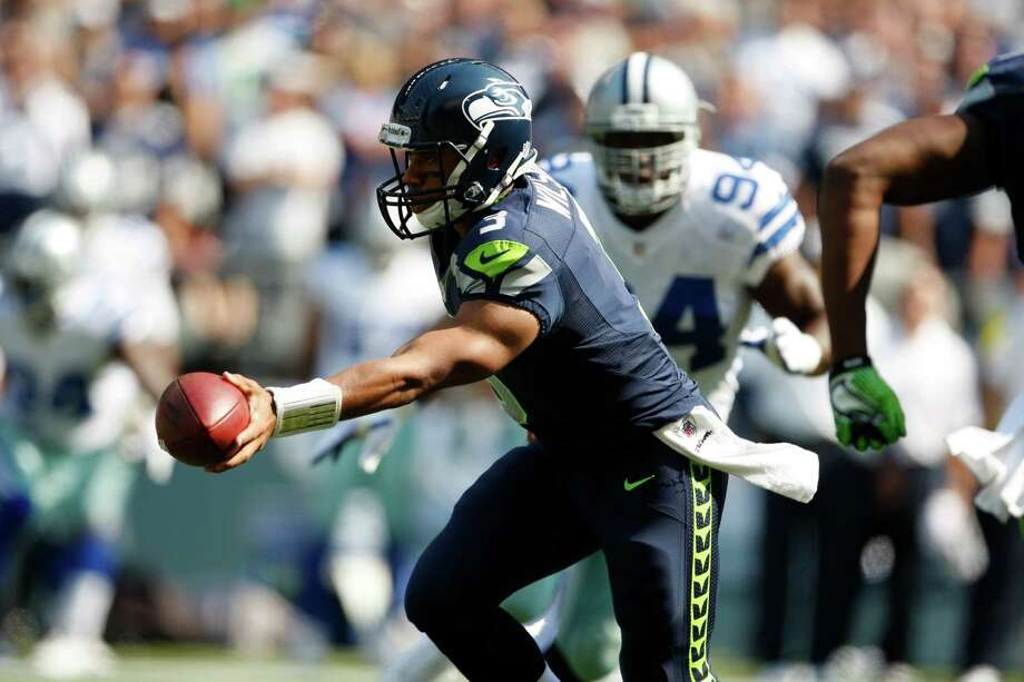 Seattle Seahawks quarterback Russell Wilson in the first half of an NFL football game against Dallas Cowboys, Sunday, Sept. 16, 2012, in Seattle. Photo: AP
