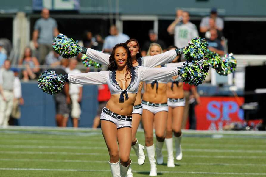 Seattle Seahawks cheerleaders in action  before an NFL football game against the Dallas Cowboys, Sun