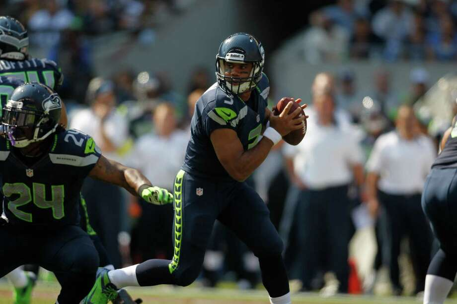 Seattle Seahawks quarterback Russell Wilson in the first half of an NFL football game, Sunday, Sept. 16, 2012, in Seattle. Photo: AP