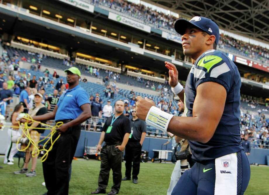 Seattle Seahawks quarterback Russell Wilson runs off the field after their 27-7 win over the Dallas Cowboys in an NFL football game, Sunday, Sept. 16, 2012, in Seattle. Photo: AP